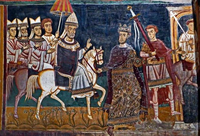 Константин I ведёт под уздцы коня на котором восседает папа Сильвестр I Фреска капеллы СанСильвестро до 1247 года Фото ruwikipediaorg
