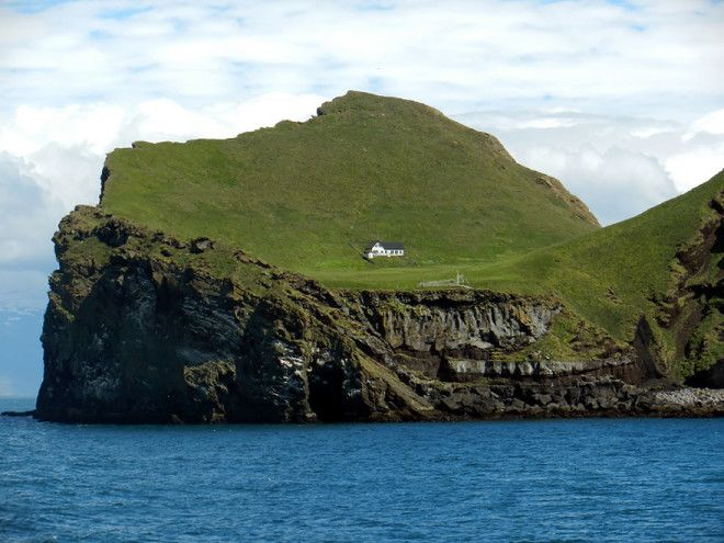 The Solitairy House Of Elliaey Island Iceland