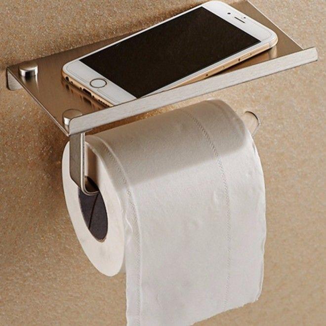 Держатель для рулона туалетной бумаги с полкой предназначенной для фиксации мобильного телефона