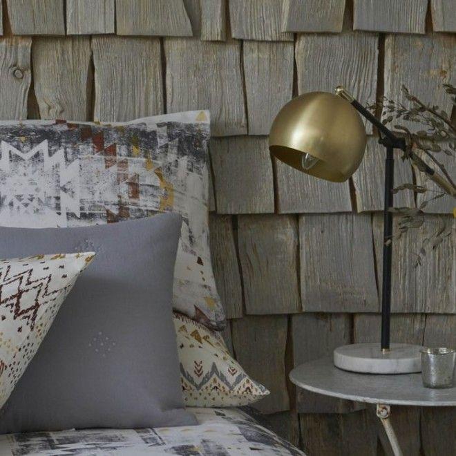 Стильный металлический акцент в интерьере спальни