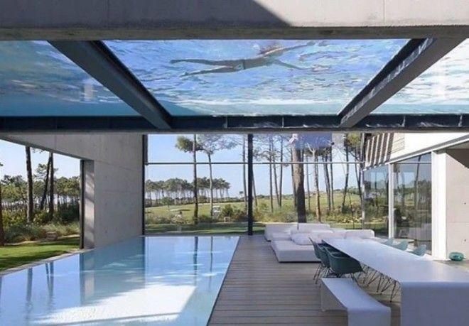 The Wall House в Португалии в котором бассейн позволяет плавать в воздухе