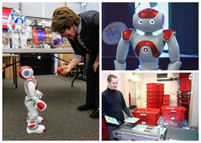 В библиотеке роботы занимаются приемом сортировкой и доставкой книг