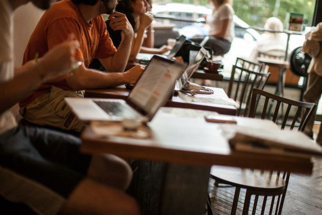 using laptop in coffee shop